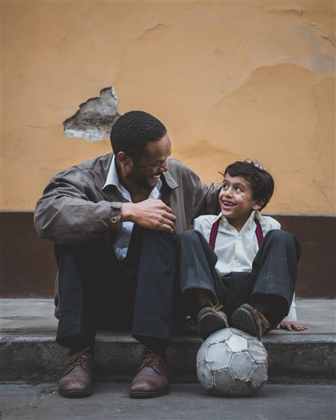 Father and son sitting - Happy- Discover joy