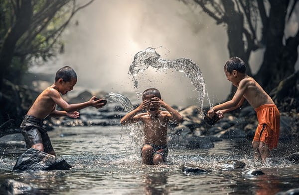 Children playing in water - Discover joy!