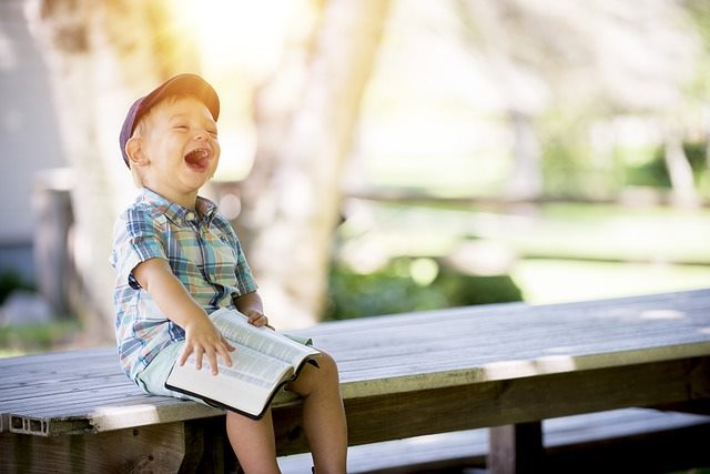 Happy little boy laughing